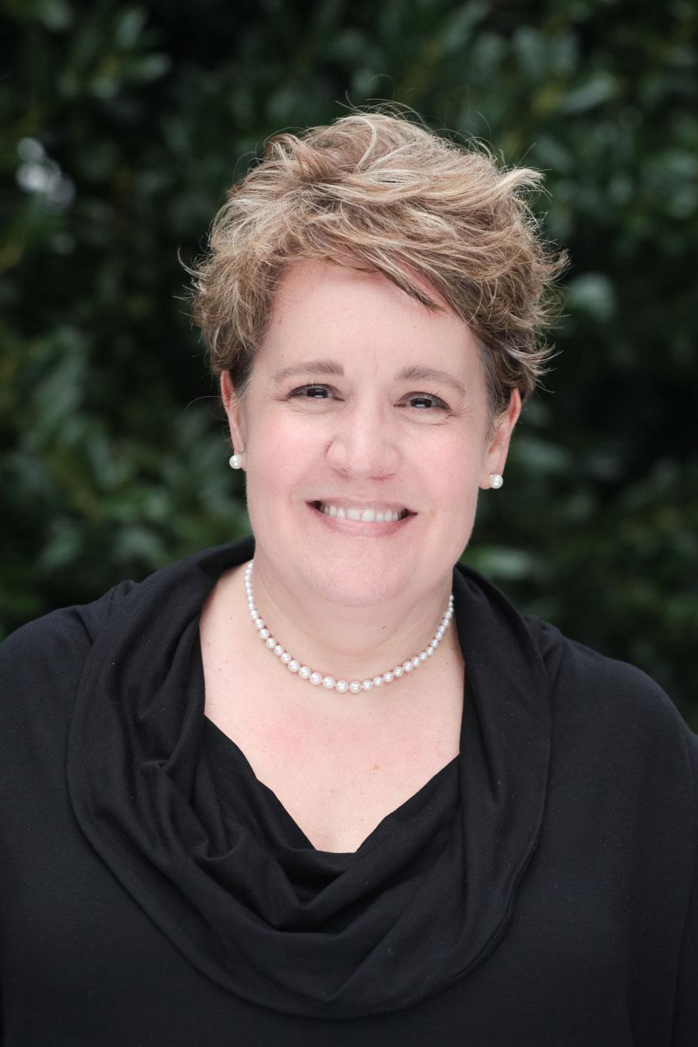 Photo of Gina St, Senior Management